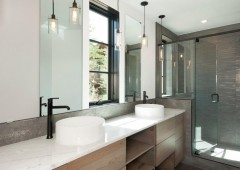 Double sink vanity offer generous space in custom cabinets for storage