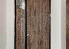 Steel metalwork adds a rustic feel to the doors