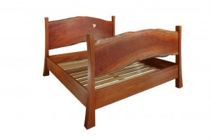 The natural edges of the headboard and footboard make this bed unique.