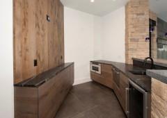 Rustic white oak cabinets in kitchenette